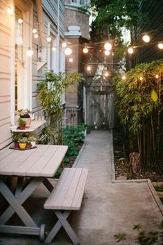Lovely patio with string lights. Love this little space.