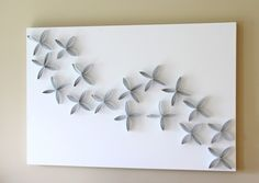"""just a girl toilet paper art. """"Very simple and fun. I used a 3 smaller canvases and painted my rolls with sample paint I had left over. I think it turned out pretty good considering it cost under $10."""""""