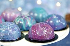 Galaxy Mousse Cakes - mini chocolate mousse cakes on a brownie base, with a gorgeous galaxy-inspired mirror glaze on top!