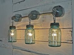 TERRIFIC - Mason Jar lights, using conduit electrical boxes on pallet boards...how original!