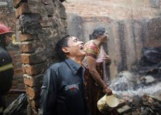 People cry after losing all of their belongings in a fire at a slum at Mirpur in Dhaka, Bangladesh on Feb. 11. According to local media, at ...