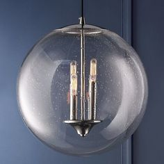 """This bubble shape pendant is the perfect balance between functionality and elegance. The pendant features clear seeded glass for added shine. Choose from three finishes: Polished Nickel, Black Iron, and Copper. 4x40 watt candelabra base lamp. (16.75""""Hx15.75""""W). Supplied with 16' of cord."""