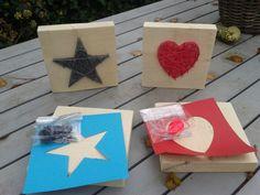 Spijkerplankje, erg makkelijk te maken voor kinderen: plank van stijger hout, spijkers en een bolletjes wol