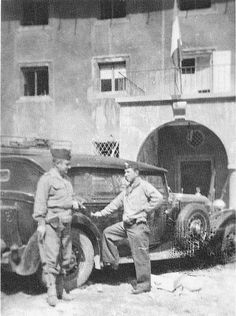 French soldiers stand beside one of Hitler's Mercedes near the Berghof at Berchtesgaden.