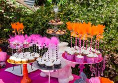 hot pink and orange cirque du bebe French circus themed baby shower cupcakes with striped straw toppers with feathers
