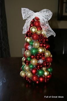 A easy and fun Christmas ornament tree made out of Dollar Store Christmas  balls.Materials needed  Styrofoam cone Tinsel garland Medium and small  (plastic)… e2d2b78dd