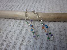 DNA double helix earrings. $18.00, via Etsy.