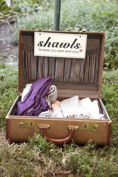 suitcase for shawls -- such a great idea!! The wedding I worked last night had pashminas to keep warm during the fireworks show!