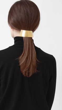 Hans Gold Barrette in large, rounded sculptural ponytail barrette in gold metal…