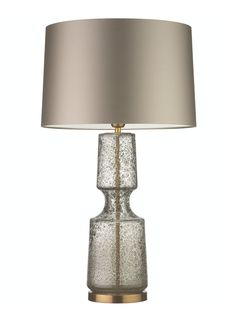 The Antero glass table lamp features a beautifully sculpted form with a concave mid-section and intricate bubble detailing. The range is available in three colours; the elegant and subtle 'Antique', the warm 'Amber Smoke', and the vivid and striking 'Teal. All colour finishes are perfectly complemented by the Antique Brass metalwork. Details Base Code: G/ANTR/ANT/AB …