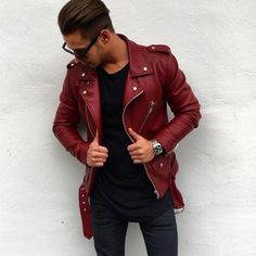 Rock a red leather jacket with navy slim jeans for a comfortable outfit that's also put together nicely.   Shop this look on Lookastic: https://lookastic.com/men/looks/red-biker-jacket-black-crew-neck-t-shirt-navy-skinny-jeans/20101   — Black Crew-neck T-shirt  — Silver Watch  — Navy Skinny Jeans  — Red Leather Biker Jacket