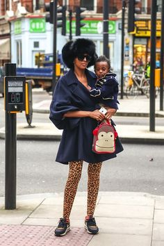 This fashion mommy knows what style means...comfortable shoes...and a Skip Hop lunchie!  :)