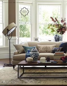 neutral living room with blue accents. Navy.