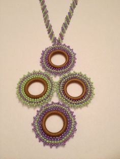 Handmade necklace .I made with brick stitch. Kolye el yapımıdır. Tuğla örme tekniği kullanılmıştır.