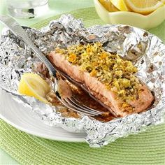 Garlic-Ginger Salmon Packets Recipe -With minimal effort and mess, this tender salmon fillet has the makings of a dinnertime staple. Citrus, garlic and ginger bring out the best in this low calorie entrée. —Lisa Finnegan, Forked River, New Jersey