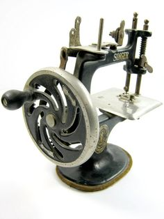 Vintage Toy Sewing Machine by DairyFarmAntiques on Etsy, $219.00 My mother still has hers.
