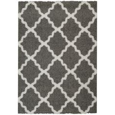 This easy to clean and affordable shaggy Moroccan trellis grey and white area rug will add comfort and texture to any room.