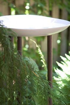 DIY a Birdbath with this Ikea Hack. diy birdbath using 3 wood dowels and a candle plate from ikea.