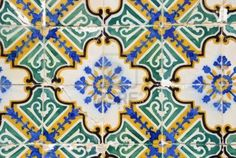 azulejos: tiles that normally surrounded doorways. http://www.123rf.com/photo_13481254_traditional-portuguese-tiles-azulejos.html