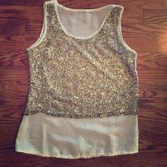 Sparkle and sheer top Love the lightness and glam of this top. Sheer in back and bottom of top sparkle area gives crop appearance(4.16-4) Tops Crop Tops