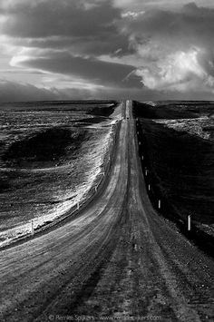 The Road (Iceland, 2008) Amazing! Great American photographer Ansel Adams almost made the same photo: Road, Nevada Desert, 1960. There's even a car approaching. I had never heard of Adams when I made my photo. How is this possible?