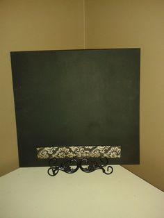 This chalkboard has a decorative ledge for your recipes and chalk.  The back of the board is cork, great for pinning those messages.  The stand is included.