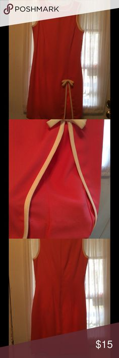 Cute coral dress! 🌹 Adorable, front looks like you can see thru slit, but you can't, nice under covering. Been in closet, so I noticed few stains, I'm sure can wash off or dry clean. Lowered my price, just for you! Color is coral with some white in collar and sleeves. Santa Fe Dresses Mini