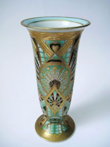 "Sold for $480 in 2012   A very desirable piece of Art Deco design Noritake porcelain, in this 7 1/4"" Flower Vase, which has a ""Cubist"" geometric decoration, in a Green, Cream, Black and Gold colouration.  It was made by the Japanese company of Noritake, at the height of the pioneering Art Deco designs production, and it dates from c 1925 -1930."