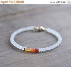 A delicate gemstone bracelet that features faceted blue flash Moonstone gems…