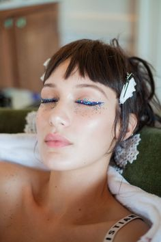 Clip-in bangs, glitter lids, and more from Bella Hadid's night out with Dior Makeup.