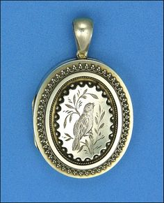 Victorian Sterling Silver Aesthetic Movement Bird Locket