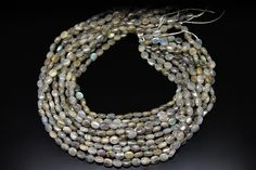 1strand  natural labradorite plain oval sized 6 by 8mm by 3yes
