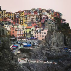 I ike this place bacause of the height. Houses are over a rock and they have a wonderful view over it. They are also painted with many bright colours! Wonderful Manarola Italy