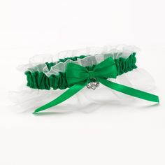 Make your wedding an even more memorable experience with this delightful Celtic wedding garter by Hortense B. Designed with bright green satin and a white chiffon ruffle, this garter is completed with a unique silver claddagh charm. Celtic Wedding, Irish Wedding, Diy Wedding, Wedding Favors, Wedding Ideas, Wedding Stuff, Wedding Shoppe, Wedding Wishes, Wedding Themes