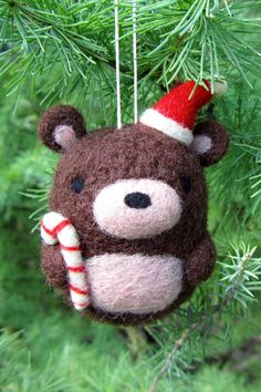 Add a little cuteness to your tree with this adorable, needle felted bear ornament.