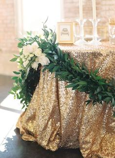 Sparkly gold table linens, for a Baylor wedding.
