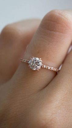 nice The perfect vintage diamond solitaire. Handset pavé side stones, double claw pr...