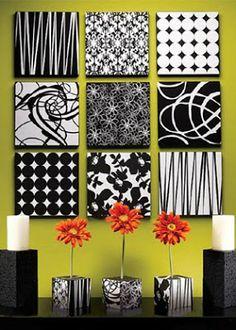 Tampas de caixas de pizza redecoradas, servindo como quadros. Uma ideia bacana e econômica para enfeitar as paredes da casa.
