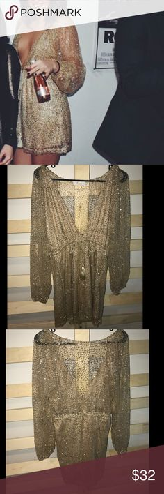Princess Polly Gold Shimmery Dress! Gorgeous gold sequence dress from the Australian boutique Princess Polly! Worn once for New Years Eve & is in great condition, I just don't have a use for it anymore! Size 10 in AU sizing, I'm a US 4-6 and it was slightly big on me. Probably fits US 6-8 best! NOT TOPSHOP Topshop Dresses Mini