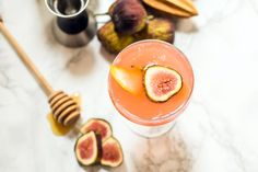 The Bee's Knees cocktail gets a seasonal update with fresh figs! You'll love this pretty pink hued cocktail.