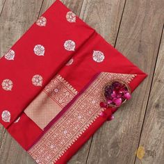 Red Pure Katan Silk Banarasi Handloom Saree - Traditional Banarasi at its finest and most classic! We're spellbound by the sheer magnificence of silk and the dazzling beauty of fine Kadhua and Roopa Sona zari work in this wholly breathtaking Banarasi saree.