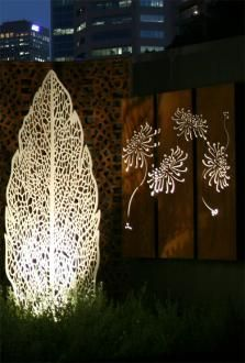 Lump leaf skeleton Sculpture and waratah screen behind.