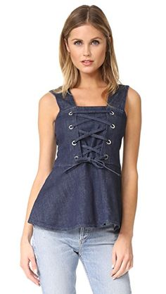 ¡Consigue este tipo de top básico de See By Chloe ahora! Haz clic para ver los detalles. Envíos gratis a toda España. See by Chloe Denim Lace Up Top: A See by Chloé top cut from dark-rinse denim. Polished grommets accent the lace-up bodice. Wide straps. Fabric: Stretch denim. 98% cotton/2% elastane. Dry clean. Made in Italy. Measurements Length: 26.5in / 67cm, from shoulder Measurements from size 38 (top básico, basic, basico, basica, básico, basicos, casual, clasica, clasicas, c...