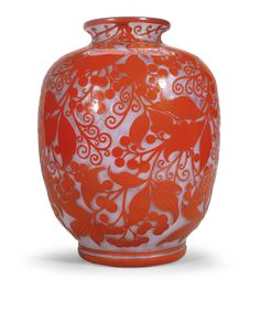 A white and red glass vase overlaid with leaves and berries by Daum<br>circa 1925, signed: <em>Daum Nancy </em> with the Croix de Lorraine | Lot | Sotheby's