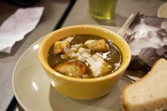 A copycat restaurant recipe for Panera Bread French Onion Soup containing white onions, beef broth, thyme, tabasco. Make it at home!