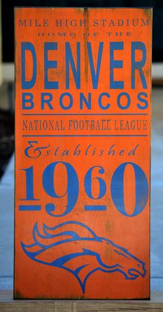Denver Broncos football distressed wood sign  by DollickDesigns, $49.99