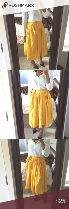 Flowy Midi Skirt!! Super cute Classic a line style midi skirt featuring front pockets, side splits, and a tie at the waist!! Beautiful golden color that can easily transition into fall! Can be dressed up or down! Gently used condition! H&M Skirts Midi