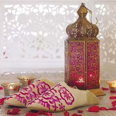 Moroccan glass lamp, cosy slippers and scented rose petals; a warm welcome