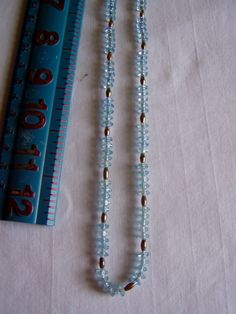 "Light Blue and Gold Bead String Necklace 27"" - for sale at Wenzel Thrifty Nickel ecrater store"