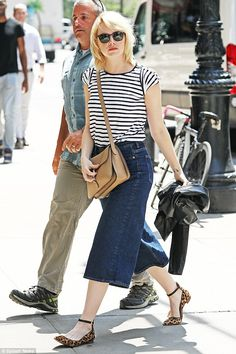 Glam: She never fails to make a savvy sartorial choice. So it came as no surprise to see Emma Stone looking effortlessly chic as she stepped out in New York on Thursday, soaking up the sun on her outing